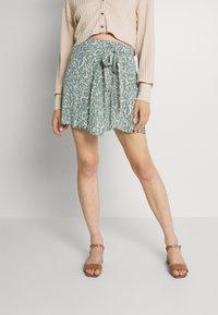 Vero Moda - VMLIVA MINI WRAP SKIRT - Mini skirt - laurel wreath/liva - 0