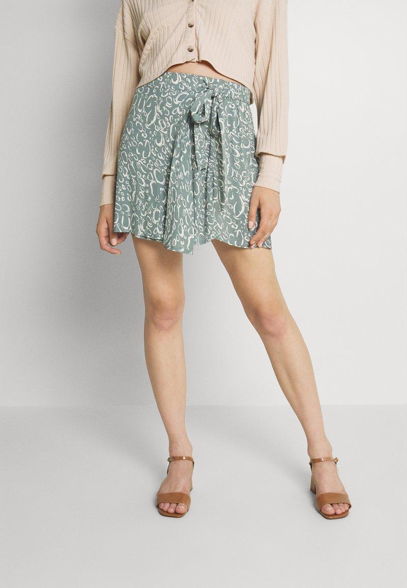 Vero Moda - VMLIVA MINI WRAP SKIRT - Mini skirt - laurel wreath/liva