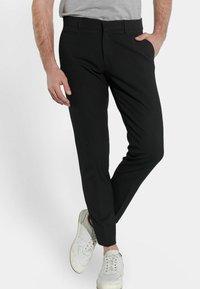 Steffen Klein - Suit trousers - schwarz - 0