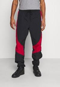 Jordan - Tracksuit bottoms - black/gym red - 0