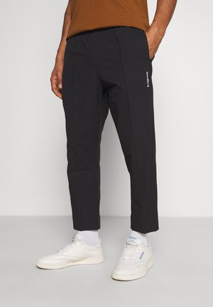 HANSI TRACK PANT - Trousers - black