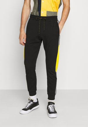 TROUSERS SLIM FIT IN TERRY FABRIC WITH RUBBER - Pantalones deportivos - black
