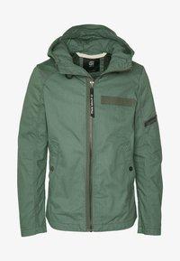 BATT HOODED - Summer jacket - grey moss