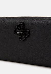 Guess - NOELLE LARGE ZIP AROUND - Wallet - black - 4