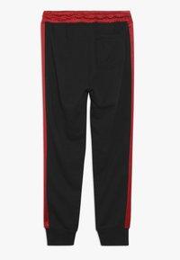 Jordan - REMASTERED PANT - Pantalones deportivos - black - 1