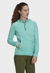 adidas Performance - Fleece jacket - green - 4