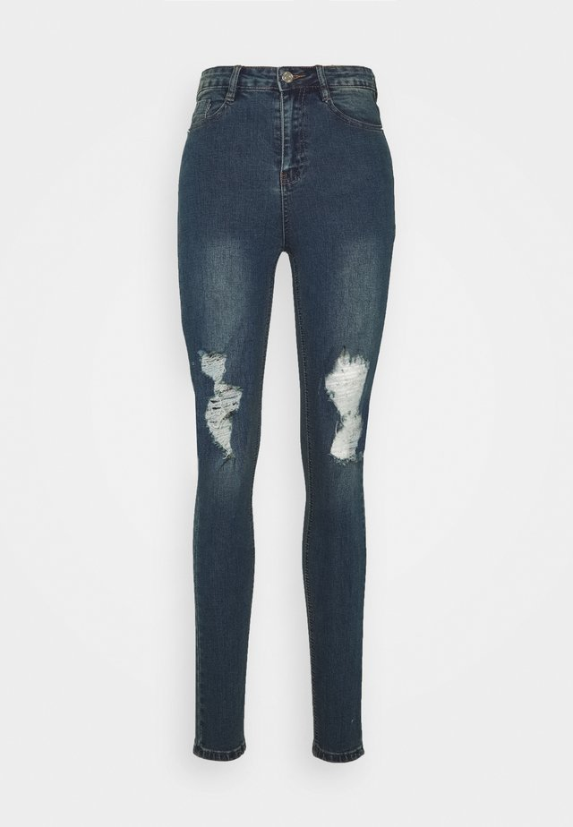 SINNER DISTRESSED JEANS - Vaqueros pitillo - blue