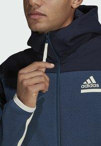 adidas Performance - Z.N.E HOODIE PRIMEGREEN HOODED TRACK TOP - Huvtröja med dragkedja - blue - 3