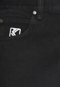 Karl Kani - RINSE PANTS - Jeans relaxed fit - black - 7