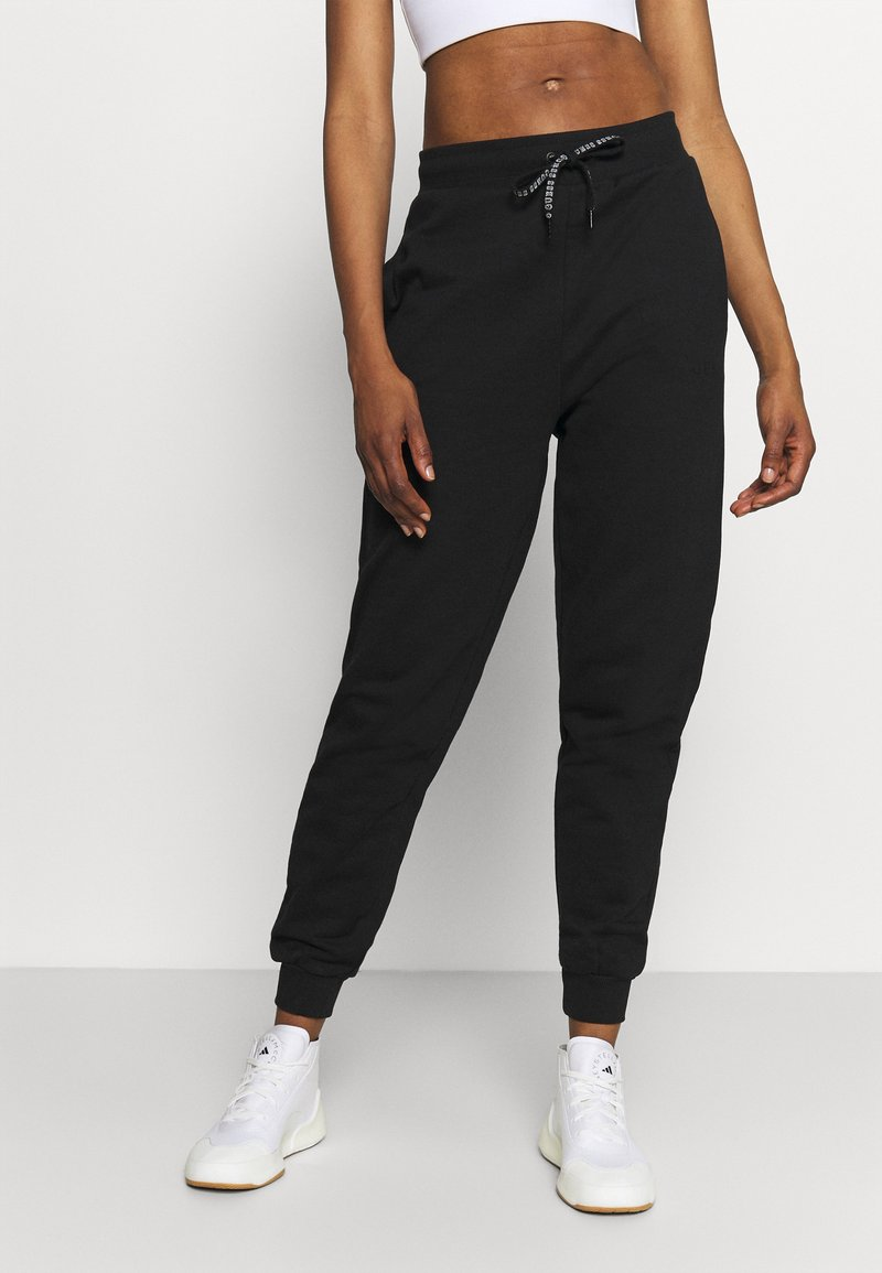 Guess - CUFF PANT - Tracksuit bottoms - jet black