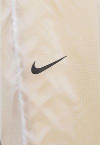 Nike Sportswear - PANT - Tracksuit bottoms - dark citron/white/black - 7