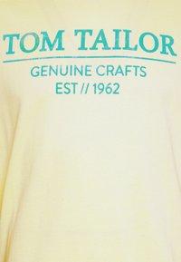 TOM TAILOR - Print T-shirt - pale straw yellow - 6