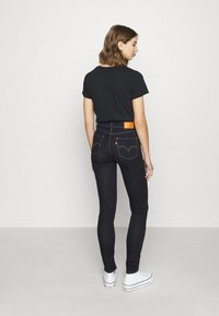 Levi's® - 721™ HIGH RISE SKINNY - Jeansy Skinny Fit - rinsed denim - 4