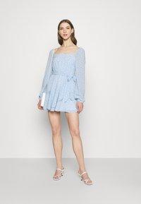 NA-KD - PAMELA REIF X ZALANDO OVERLAPPED FRILL MINI DRESS - Day dress - dusty blue - 1