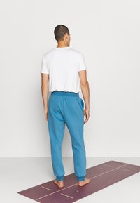 Curare Yogawear - LONG PANTS - Trainingsbroek - light blue - 2