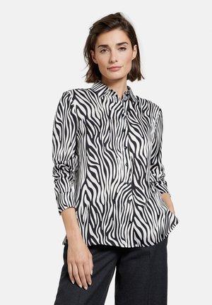 LANGARM MIT ZEBRAMUSTER - Button-down blouse - schwarz/ecru/weiss druck