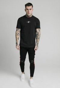 SIKSILK - BURST KNEE - Vaqueros pitillo - black - 1