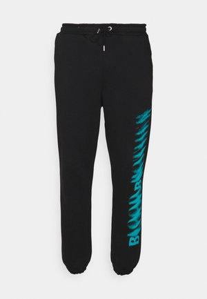LEG PRINT - Trainingsbroek - black