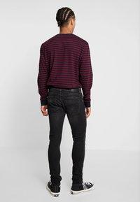 Nudie Jeans - SKINNY LIN - Jeans Skinny Fit - worn black - 2