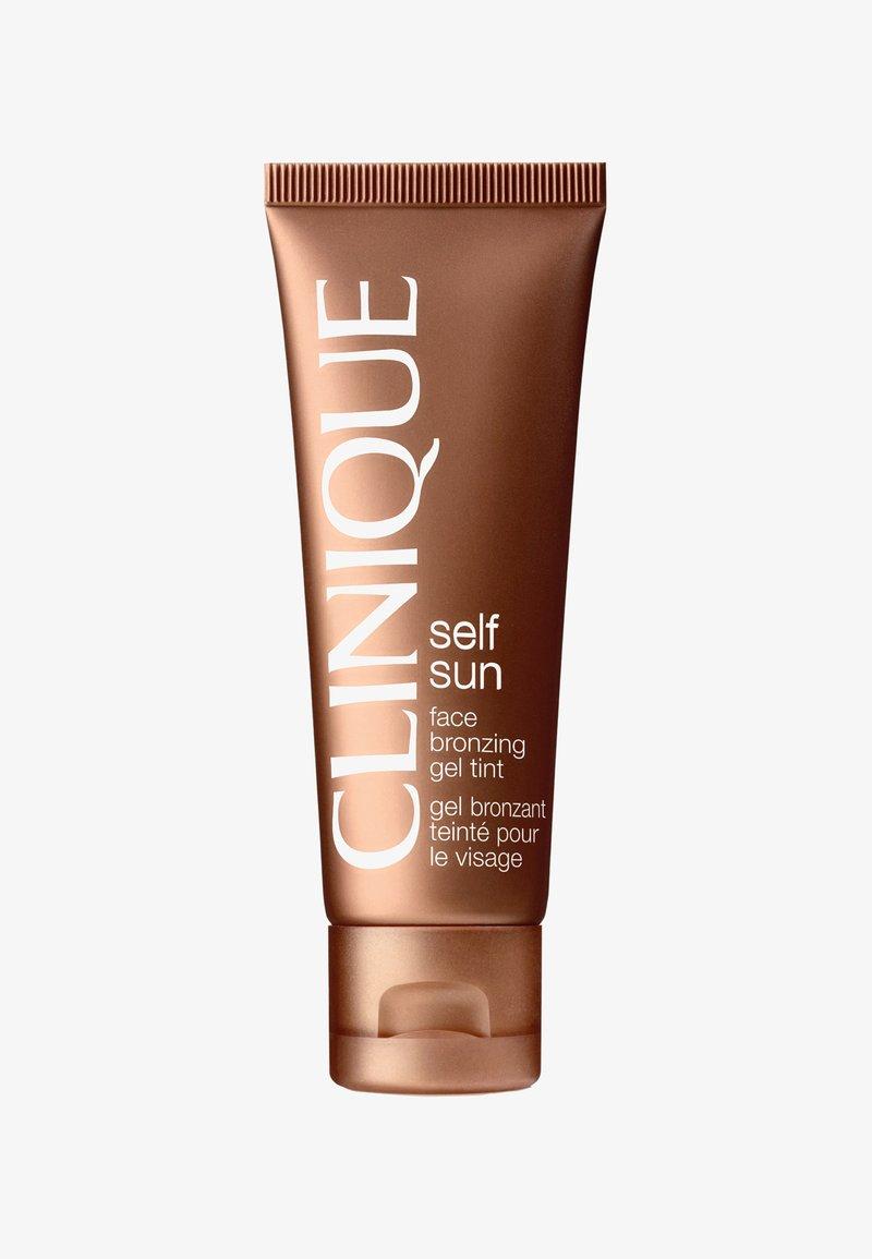 Clinique - FACE BRONZING GEL TINT  - Self tan - -