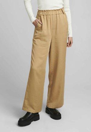 NUCHAVA  - Trousers - tannin