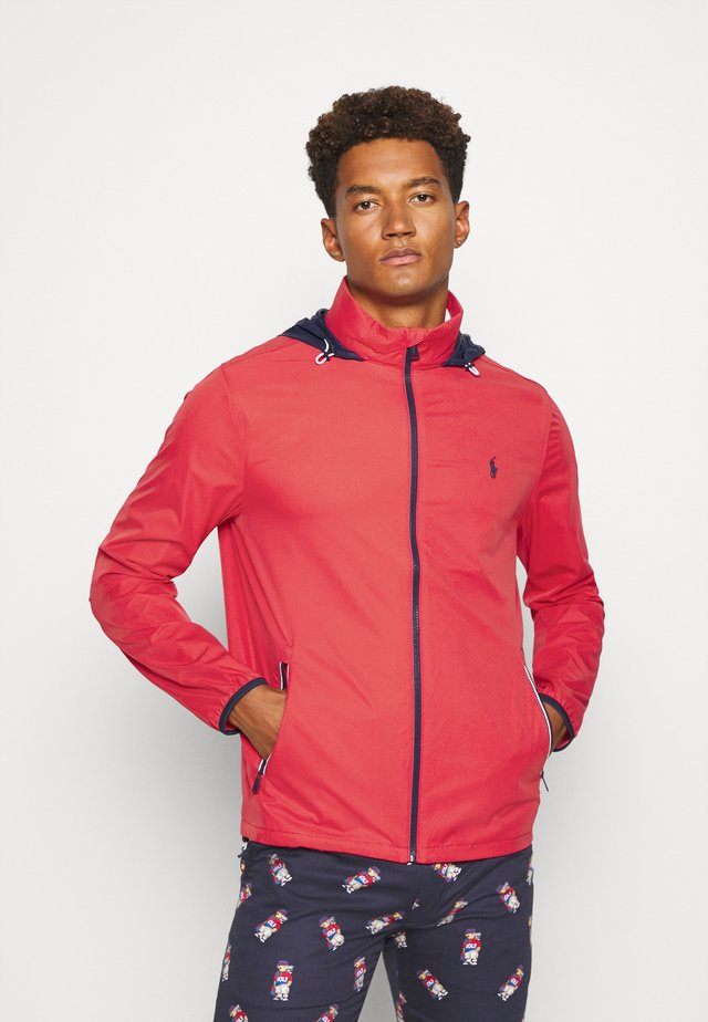 HOOD ANORAK JACKET - Waterproof jacket - sunrise red