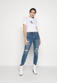 Calvin Klein Jeans - MONOGRAM MODERN STRAIGHT CROP - Print T-shirt - bright white - 1