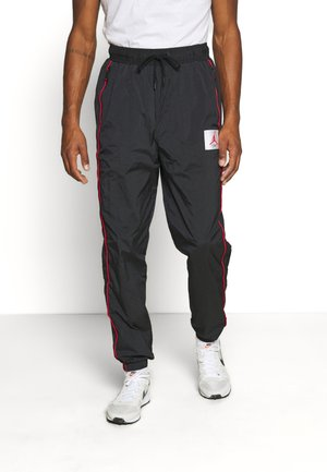 FLIGHT WARMUP PANT - Jogginghose - black/university red