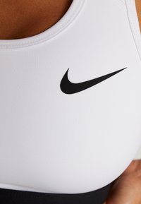Nike Performance - MED BAND BRA NON PAD - Sports bra - white/black - 4