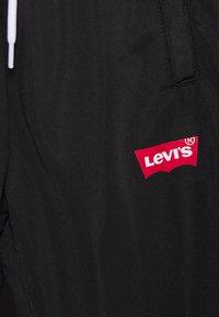 Levi's® - Teplákové kalhoty - black - 2