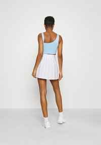 Karl Kani - SMALL SIGNATURE TENNIS SKIRT - Mini skirt - white - 2