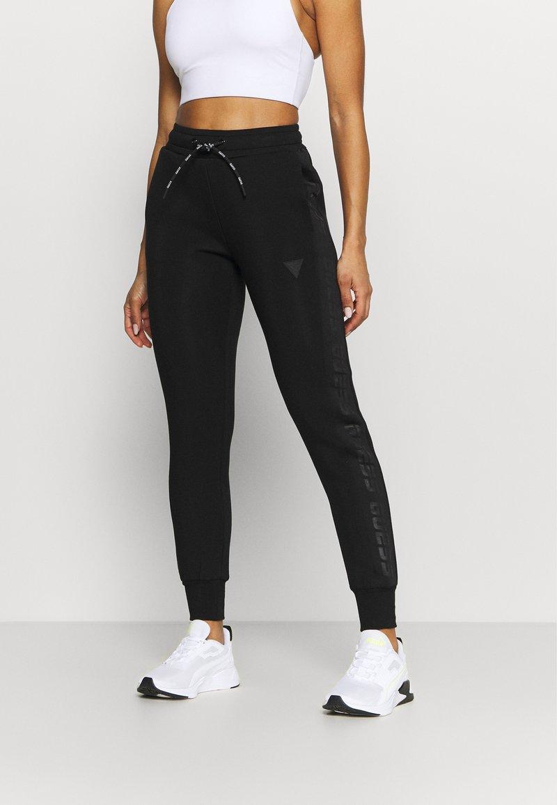Guess - LONG PANT - Tracksuit bottoms - jet black