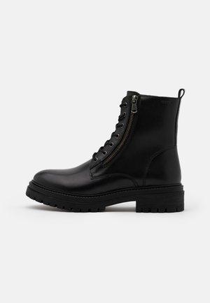 IRIDEA - Platform ankle boots - black