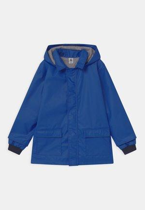 HOODED UNISEX - Veste imperméable - blue