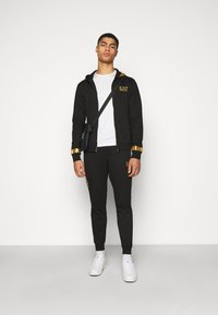 EA7 Emporio Armani - Zip-up hoodie - black/gold - 1