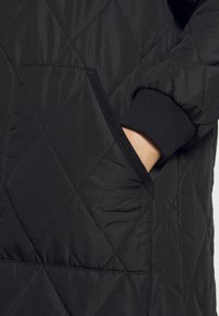 ONLY Carmakoma - CARCARROT LONG QUILTED JACKET - Classic coat - black - 4