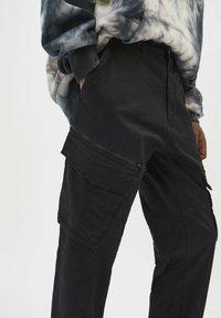 PULL&BEAR - Cargo trousers - black - 4