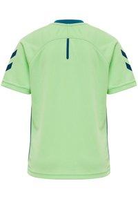 Hummel - ACTION  - Print T-shirt - green ash/blue coral - 2