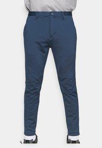 adidas Golf - PRIMEBLUE JOGGER - Pantalones - navy/white - 3