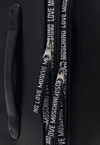 Love Moschino - Wheeled suitcase - black - 6