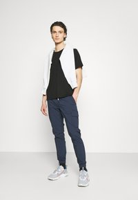 Tommy Jeans - SCANTON - Cargo trousers - blue - 1