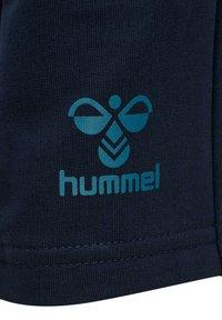 Hummel - Tracksuit bottoms - dark sapphire blue coral - 4