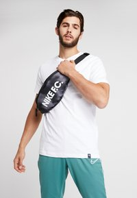 Nike Performance - HIP PACK - Bum bag - black/white - 1