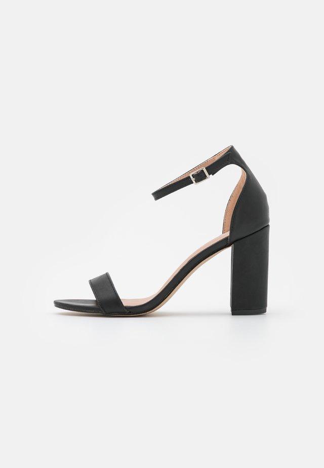 BEELLA - Sandalen met hoge hak - black paris