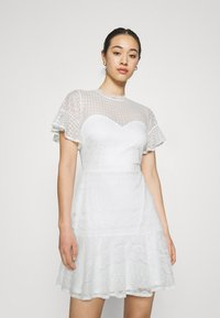 Nly by Nelly - FLOUNCE DRESS - Cocktail dress / Party dress - white - 0