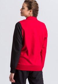 Erima - Sports jacket - red/black/white - 2
