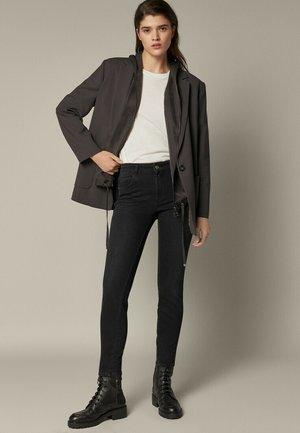 MIT HALBHOHEM BUND  - Jeans Skinny Fit - black