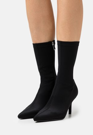 MARINDA - Classic ankle boots - black