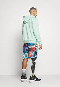 Nike Performance - DNA SHORT CITY EXPLORATION SERIES - Pantaloncini sportivi - enamel green - 2