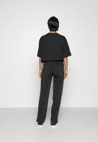 adidas Originals - FIREBIRD TP PB - Träningsbyxor - black - 3